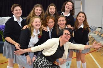 seniors and class moderator rejoice with juniors